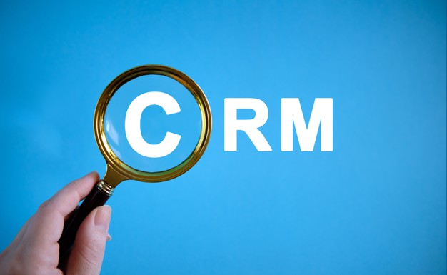 crm text with magnifying glass blue background 126791 262